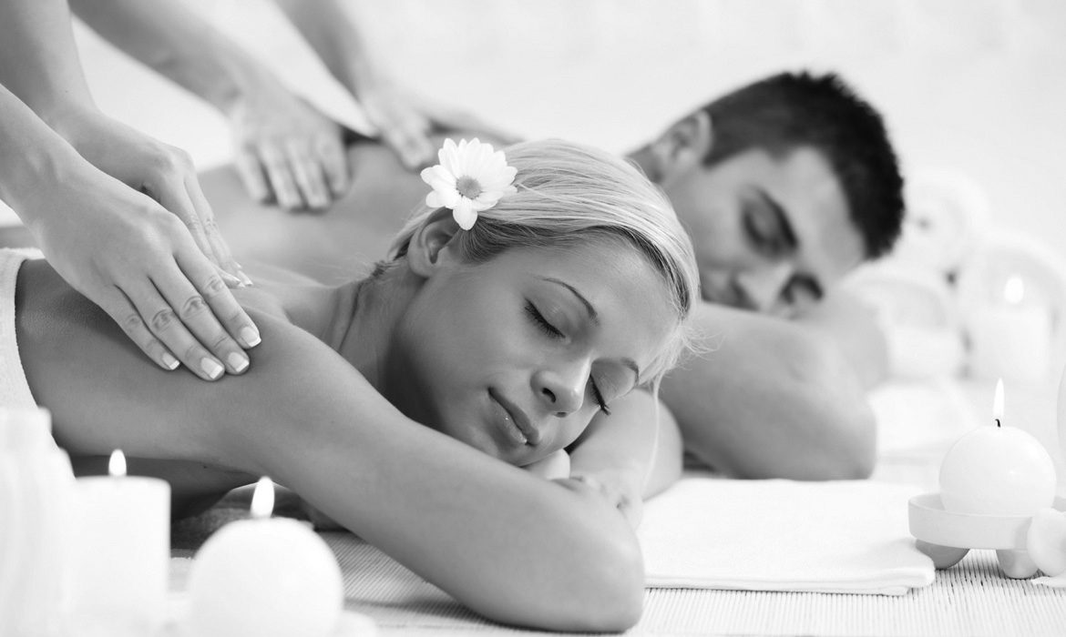 Young couple is having a back massage at the spa centre.   [url=http://www.istockphoto.com/search/lightbox/9786786][img]http://dl.dropbox.com/u/40117171/couples.jpg[/img][/url]